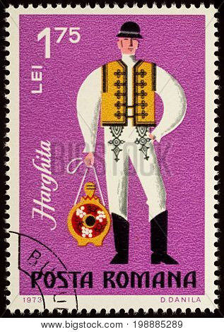 Moscow Russia - August 08 2017: A stamp printed in Romania shows young man in Romanian folklore costume Harghita county series