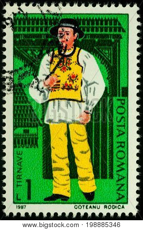 Moscow Russia - August 07 2017: A stamp printed in Romania shows young man in Romanian national costume Tarnave region series