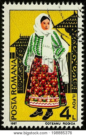 Moscow Russia - August 07 2017: A stamp printed in Romania shows young woman in Romanian national costume Ilfov region series