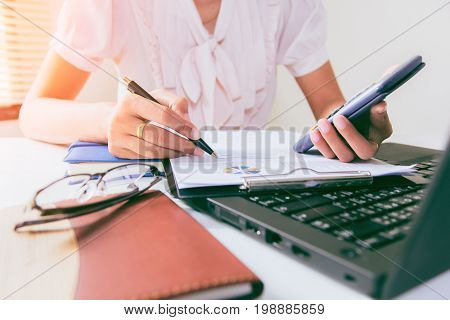 Businesswoman calculate about cost and doing finance at home office Finance managers taskConcept business and finance investment