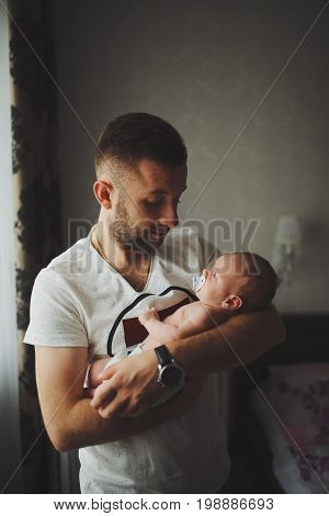 young happy father with cute baby portrait