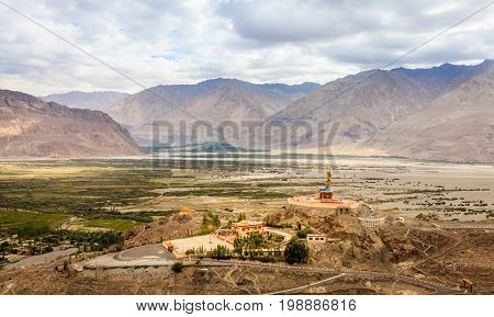 View to Nubra Valley and Maitreya Buddha statue from Diskit Monastery in Kashmir, India