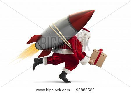 Santa Claus with gift box ready to fly with a rocket in the sky isolated on white background