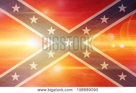 Confederate flag on bright sunny sky