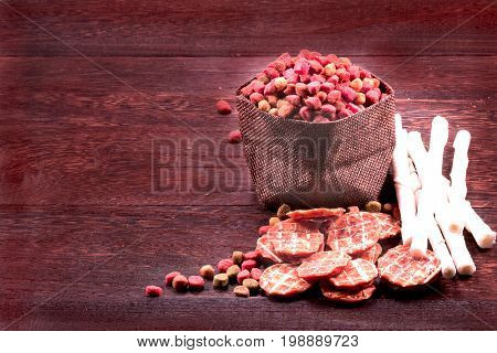 Dog snack, dog chews ,dog biscuits  on a grey wooden table wall background with copy space .