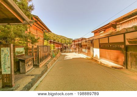Country road at Narai is a small town and the old town soft focus provided a pleasant walk through about a kilometre of well preserved buildings in Nagano Prefecture Japan.