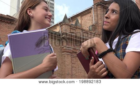 Teen Student Thinking Or Deciding Holding Books