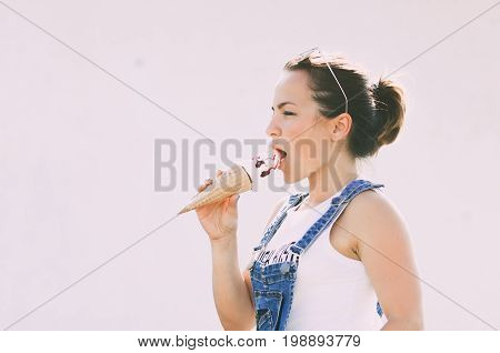 Girl On A Light Background Eating Ice Cream