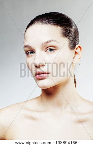 young sweet brunette woman close up isolated on white background, perfect pure innocense freshness face, spa healthcare real people concept