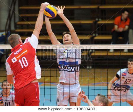 KAPOSVAR, HUNGARY - OCTOBER 15: Krisztian Csoma (C) blocks the ball at a Middle European League volleyball game Kaposvar (HUN) vs hotVolleys (AUT), October 15, 2010 in Kaposvar, Hungary