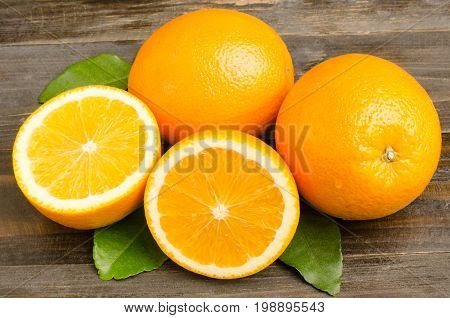 Navel orange fruit on wooden background,healthy fruit and high vitamin C