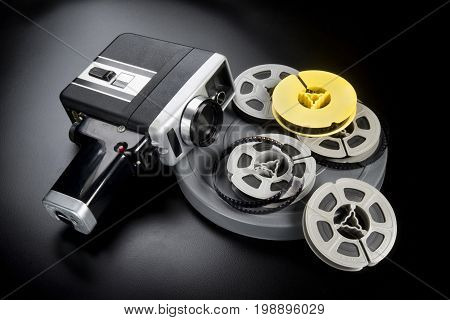 8mm movie camera and reels of film.