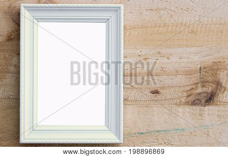 Close up white picture frame put on wooden wall background with space use for picture or texts display