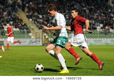 KAPOSVAR, HUNGARY - OCTOBER 23: Milan Peric (in white) in action at a Hungarian National Championship soccer game Kaposvar vs Budapest Honved October 23, 2010 in Kaposvar, Hungary.