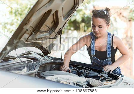 Girl Near Car With Open Hood