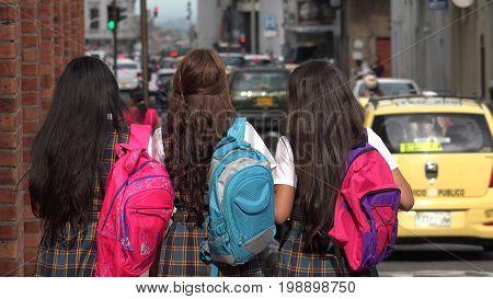Inner City School Kids With Backpacks Walking To School