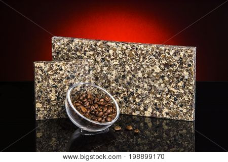 Counter. Brown kitchen counter top sample with coffee on black surface. Granite counter. Natural stone counter made of granite.