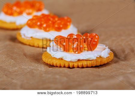 Red Caviar In Fish-shape Bowl With Crackers, Closeup, Selective Focus