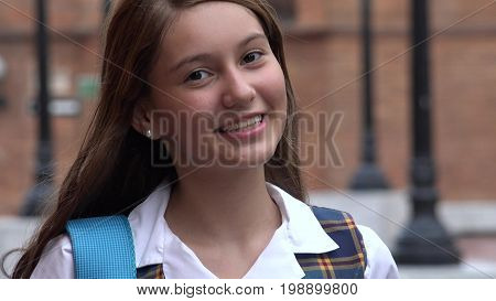 A Smiling and Young Teen Girl Student