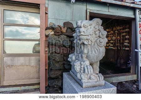 Komainu lion-dog guardian statue of Kusushi Shinto Shrine on the summit of Mount Fuji