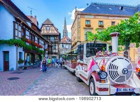 Obernai France - July 17 2017: Tourist excursion train in an Obernai town center. Obernai is one of the most beautiful town on the wine route in Alsace France