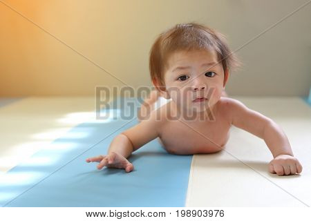 Adorable Baby Boy Trying Crawl Clamber First Time, Cute Asian Child Newborn 3 Months Happy Relaxing