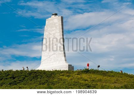KILL DEVIL HILLS, NORTH CAROLINA - JULY 14, 2017:  Visitors on Kill Devil Hill tour the granite tower commemorating the flights of Wilbur and Orville Wright at the Wright Brothers National Memorial.