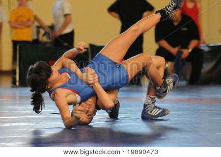 KAPOSVAR, HUNGARY - NOVEMBER 6: Unidentified competitors wrestle int he Intersport Cup Greco Roman Wrestling Competition, November 6, 2010 in Kaposvar, Hungary.