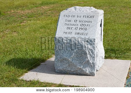 KILL DEVIL HILLS, NORTH CAROLINA - JULY 14, 2017:  Stone marker indicating the landing site of the first successful flight by Wilbur and Orville Wright at the Wright Brothers National Memorial.