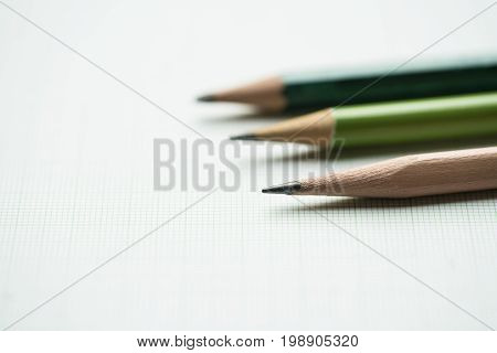 pencils on graph paper research and education concept