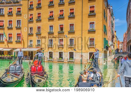 Venice, Italy - May 12, 2017 : Views Of The Most Beautiful Channel Of Venice, Narrow Streets, Houses