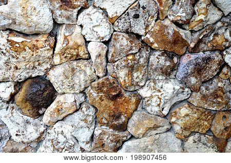 Background of stone wall texture, rough stoned wall