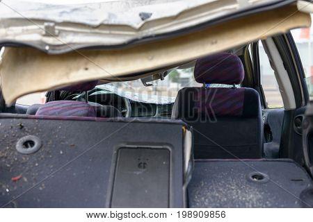 Damaged Car With Broken Windshield