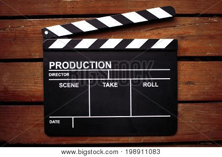 The Clapper board on tree texture background