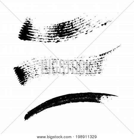 Set of 3 artistic mascara black strokes. Qualitative trace of real mascara texture. Different black swirls isolated on a white background.