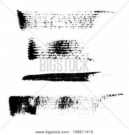 Set of 4 artistic mascara black strokes. Qualitative trace of real mascara texture. Different black swirls isolated on a white background.