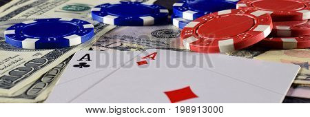 Close up of playing cards, poker chips and money. Panorama image.