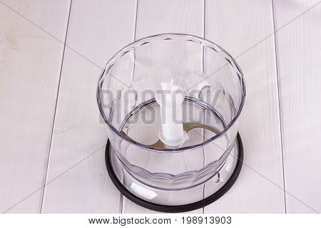 Plastic blender with steel knives top view on white background