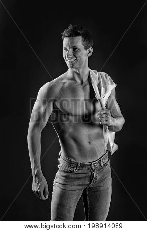 Sport and workout. Athletic bodybuilder pose. Man with muscular body. Gladiator or atlant. Guy with bare chest in jeans and shirt.