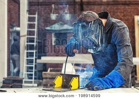 Man  Welds A Metal Welding