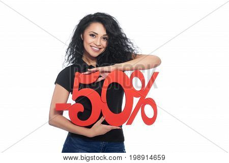 Studio shot of a beautiful happy Hispanic woman smiling joyfully holding -50 sale sign isolated on white discount seller offer sales pricing price consumerism shopping concept.