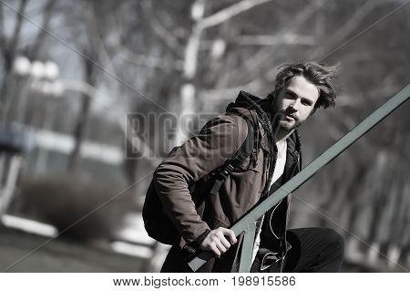 Bearded Man In Brown Hoodie Jacket With Sport Bag
