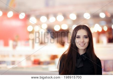Smiling Elegant Woman Wearing  Black Shirt and Bowtie Standing Indoors