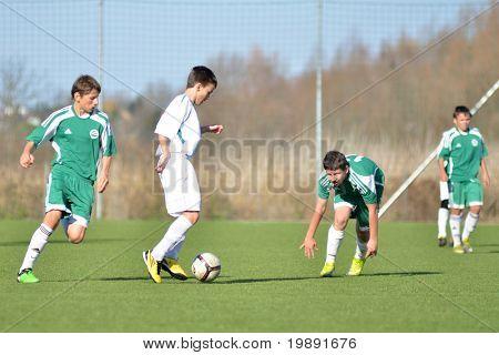 KAPOSVAR, HUNGARY - NOVEMBER 13: Unidentified players in action at the Hungarian National Championship under 15 game between Kaposvar and Gyori ETO November 13, 2010 in Kaposvar, Hungary.