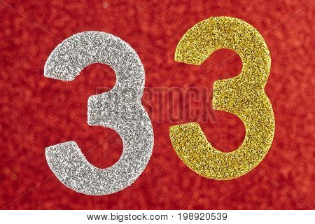 Number thirty-three yellow silver color over a red background. Anniversary
