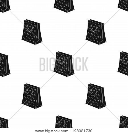 Gift package with beautiful patterns, stars and handles in the form of ropes.Gifts and Certificates single icon in black style vector symbol stock web illustration.