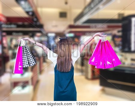 Beauty Woman with Shopping Bags in Shopping Mall. Shopper. Sales. Shopping Center