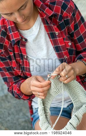 Young Woman Knits A  Sweater
