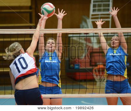KAPOSVAR, HUNGARY - DECEMBER 12: Zsanett Pinter (2) in action at the Hungarian NB I. League woman volleyball game Kaposvar vs Eger on December 12, 2010 in Kaposvar, Hungary.