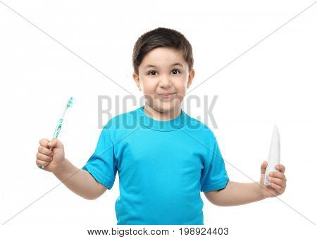 Cute boy with toothbrush and paste on white background. Teeth cleaning concept